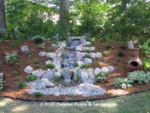 Pondless waterfall installation in Wayzata MN. Click photo to enter gallery