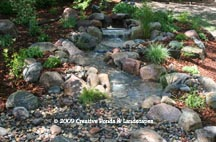 Pondless waterfall & Landscape installation in Minneapolis MN