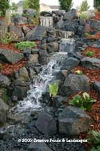 Pondless waterfall & landscape installation in Woodbury, MN. Click photo to enter gallery