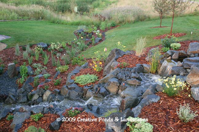 Photo of Pondless waterfall & landscaping installation in St. Paul MN