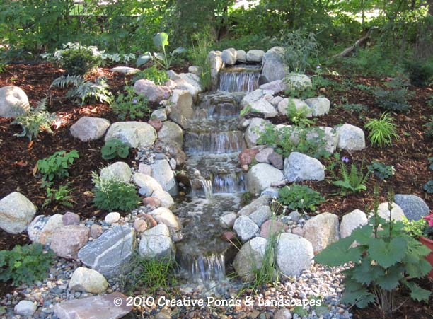 Pondless waterfall landscape installation in wayzata mn for Waterfall installation